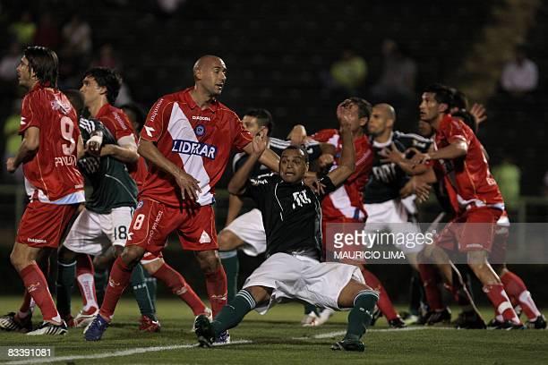 Argentinos Juniors' Juan Mercier fights for the ball with Palmeiras' Denilson during their Copa Sudamericana quarterfinal football match held at...