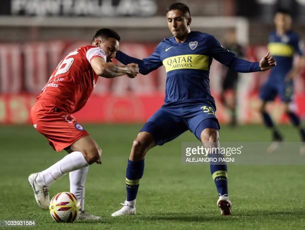 Argentinos Juniors' midfielder Matias Romero vies for the ball with Boca Juniors' midfielder Agustin Almendra during their Argentina First Division...