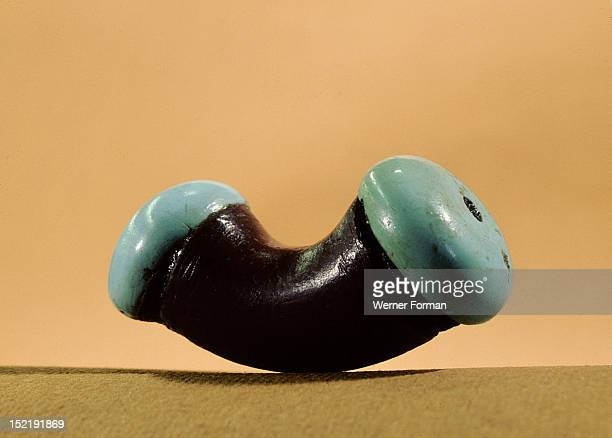 Argillite nose plug fitted with turquoise ends, USA. Sinagua. C 1200 AD.