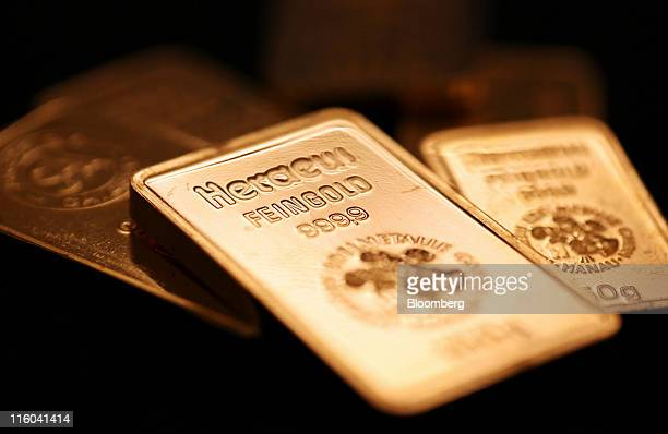Argor Heraeus SA branded gold bars are seen in this arranged photograph at Gold Investments Ltd bullion dealers in London UK on Tuesday June 14 2011...