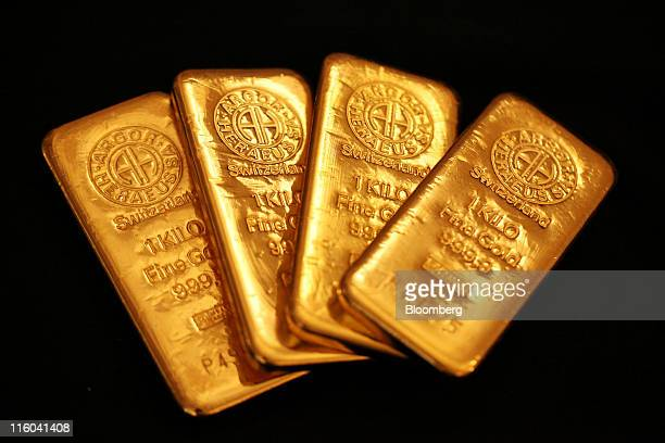 Argor Heraeus SA branded one kilogram gold bars are seen in this arranged photograph at Gold Investments Ltd bullion dealers in London UK on Tuesday...