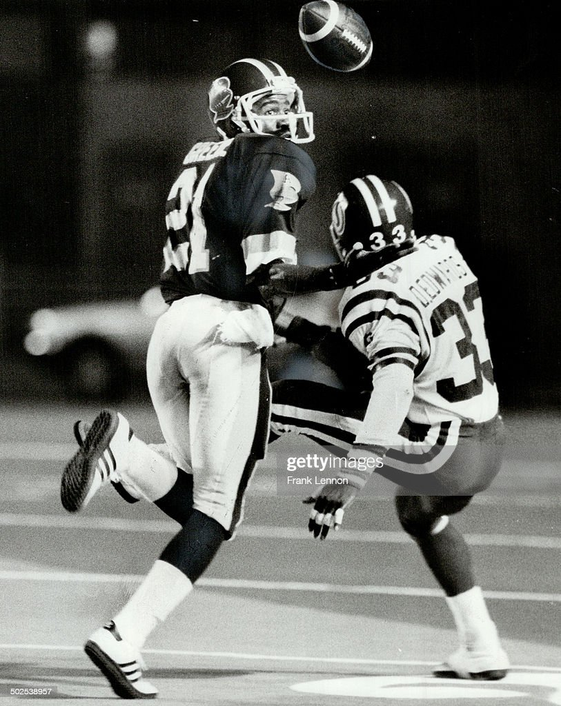 Argos' Marcellus Greene; left; fights for ball with Roughriders' Dwight Edwards; a former Argo; and  : News Photo