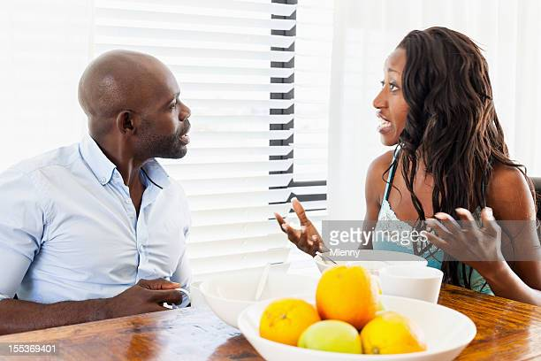 Arguing couple during breakfast