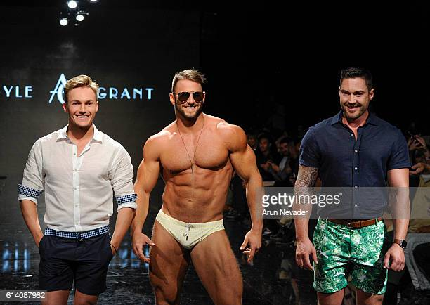Argyle Grant fashion designers walk the runway with a model at Art Hearts Fashion Los Angeles Fashion Week presented by AIDS Healthcare Foundation on...