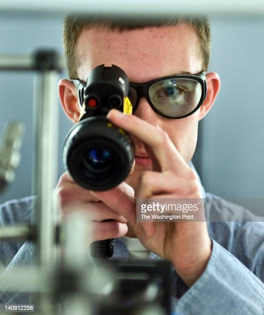 Ari Dyckovsky poses with a scope in the Physical Measurement Lab that deals with quantum computing and simulation Monday March 5 2012 in Gaithersburg...