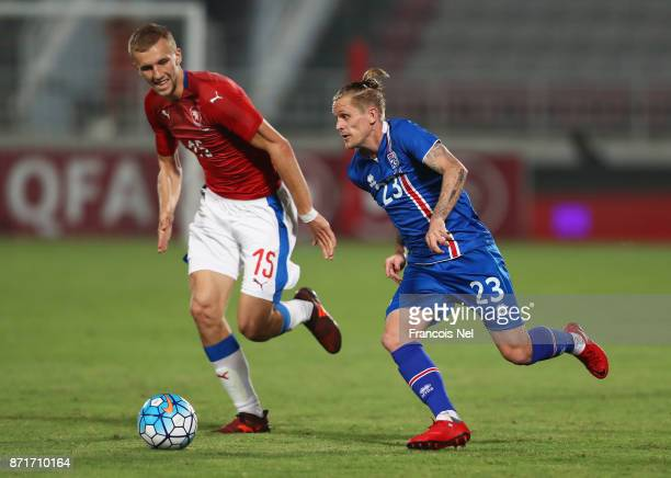 Ari Freyr Skulason of Iceland is chased by Tomas Soucek of the Czech Republic during the international friendly match between Iceland and Czech...