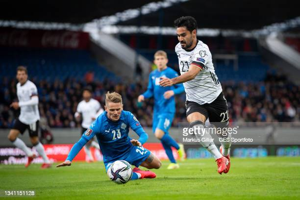 Ari Freyr Skulason of Iceland is tackled by Ilkay Guendogan of Germany during the 2022 FIFA World Cup Qualifier match between Iceland and Germany at...