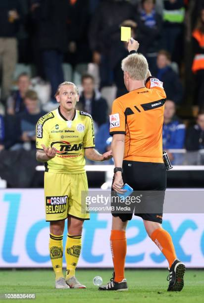 Ari Freyr Skulason receives a yellow card from Christof Dierick during the Jupiler Pro League match between Club Brugge and KSC Lokeren OV at Jan...