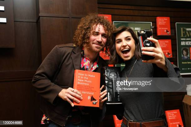 Ari Herstand poses with a guest as he celebrates his book How To Make It in the New Music Business at Barnes Noble at The Grove on January 16 2020 in...