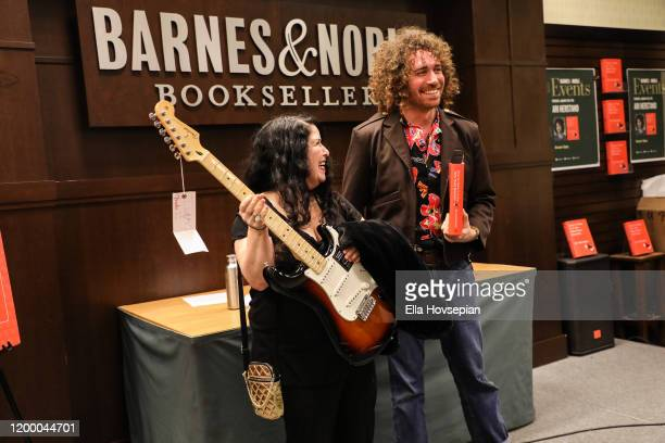 Ari Herstand poses with a raffle winner as he celebrates his book How To Make It in the New Music Business at Barnes Noble at The Grove on January 16...