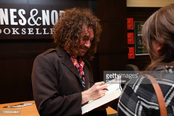 Ari Herstand signs his book How To Make It in the New Music Business at Barnes Noble at The Grove on January 16 2020 in Los Angeles California