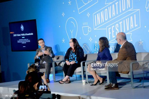 Ari Melber Rachel Bitecofer Neera Tanden and Rick Wilson speak on stage at the 2020 Vision Political Roundtable panel at the on November 07 2019 in...