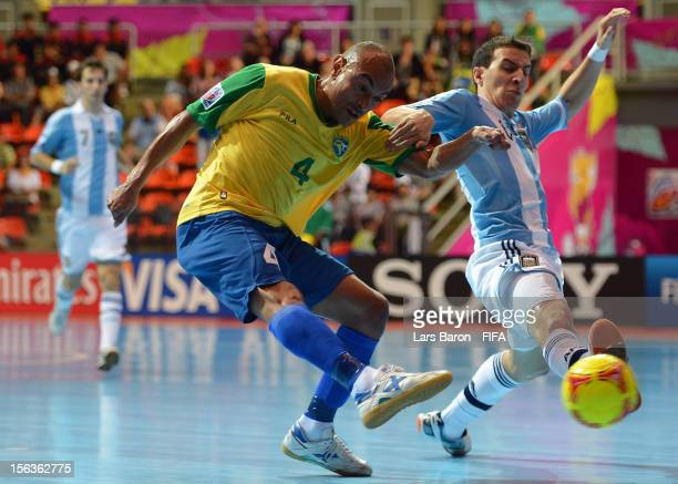 Ari of Brazil is challenged by Maximiliano Rescia of Argentina during the FIFA Futsal World Cup QuarterFinal match between Argentina and Brazil at...