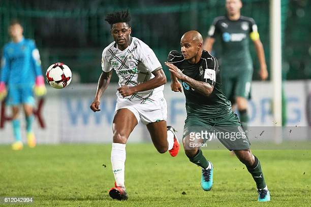 Ari of FC Krasnodar is challenged by Alex Song of FC Rubin Kazan during the Russian Premier League match between FC Krasnodar v FC Rubin Kazan at...