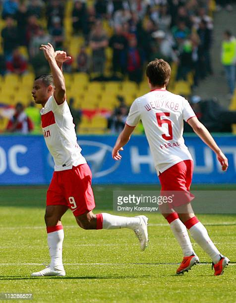 Ari of FC Spartak Moscow celebrates with teammate Aleksandr Sheshukov after scoring the opening goal during the Russian Premier League match between...