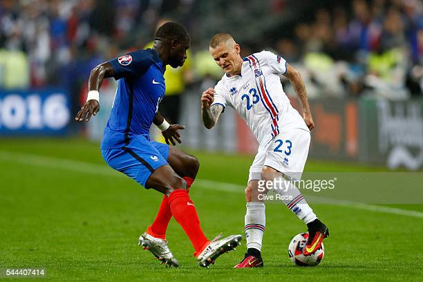 Ari Skulason of Iceland and Eliaquim Mangala of France compete for the ball during the UEFA EURO 2016 quarter final match between France and Iceland...