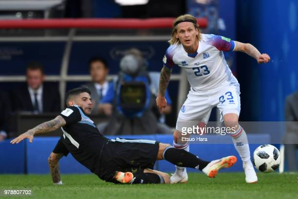 Ari Skulason of Iceland and Ever Banega of Argentina compete for the ball during the 2018 FIFA World Cup Russia group D match between Argentina and...
