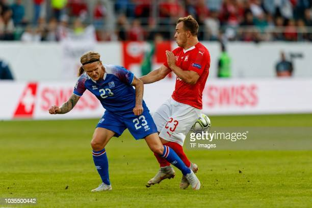 Ari Skulason of Iceland and Xherdan Shaqiri of Switzerland battle for the ball during the UEFA Nations League A group two match between Switzerland...