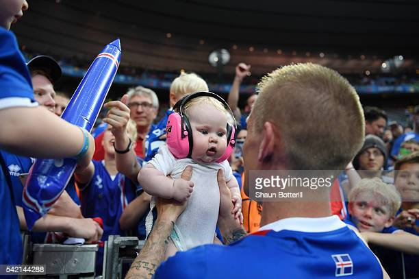 Ari Skulason of Iceland celebrates his team's 21 win with his child after the UEFA EURO 2016 Group F match between Iceland and Austria at Stade de...