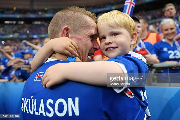 Ari Skulason of Iceland celebrates his team's 21 win with his children after the UEFA EURO 2016 Group F match between Iceland and Austria at Stade de...