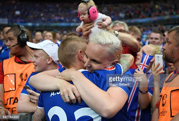 Ari Skulason of Iceland celebrates his team's 21 win with his wife after the UEFA EURO 2016 Group F match between Iceland and Austria at Stade de...