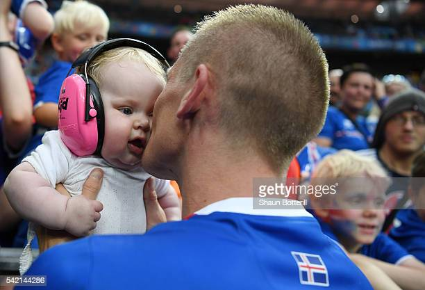 Ari Skulason of Iceland kisses to his child to celebrate his team's 21 win with his children after the UEFA EURO 2016 Group F match between Iceland...