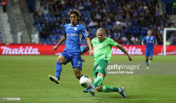 Ari Skulason of Kv Oostende battles for the ball with Junya Ito of Krc Genk during the Jupiler Pro League match between KRC Genk and KV Oostende at...