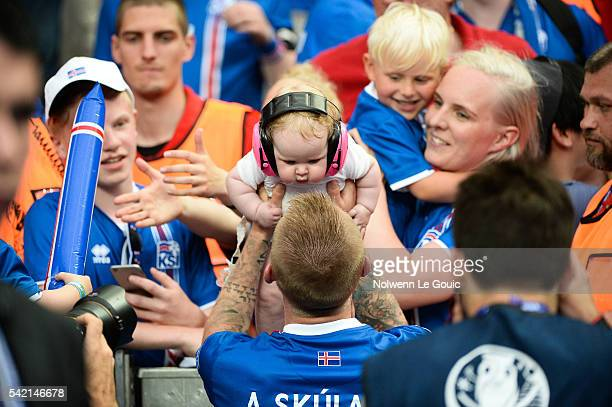 Ari Skulasson of Iceland celebrates qualification with his baby during the UEFA EURO 2016 Group F match between Iceland and Austria at Stade de...