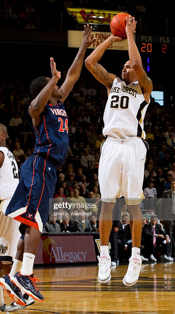 Ari Stewart #20 of the Wake Forest Demon Deacons takes a jump shot over KT Harrell #24 of the Virginia Cavaliers at the Lawrence Joel Coliseum on January 29, 2011 in Winston Salem, North Carolina. The Demon Deacons defeated the Cavaliers 76-71.