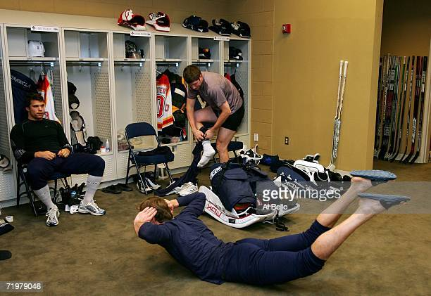 Ari Vallin Alexei Semenov and Jean Marc Pelletier of The Florida Panthers prepare before a morning practice prior to the game against The New York...