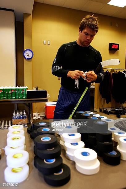Ari Vallin of The Florida Panthers works on his stick before a morning practice prior to the game against The New York Rangers on September 23 2006...