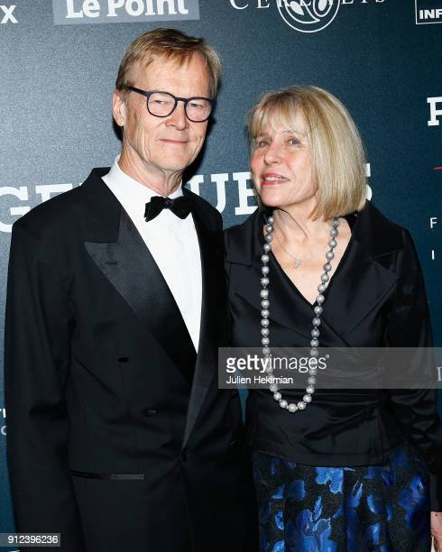 Ari Vatanen and his wife attend the 33nd International Automobile Festival At Hotel des Invalides on January 30 2018 in Paris France