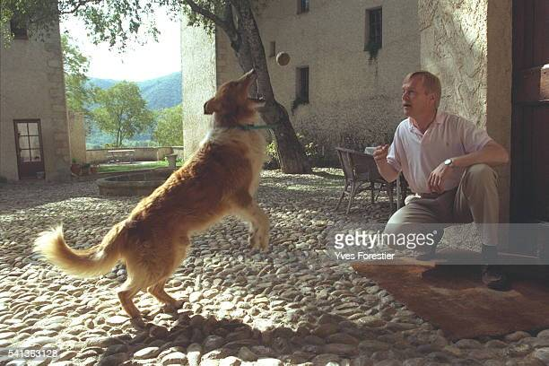 Ari Vatanen at home playing with his dog