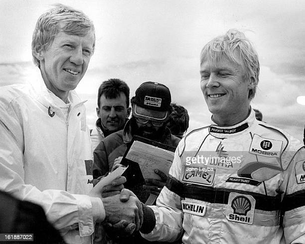 JUL 12 1987 Ari Vatanen congratulates Walter Roehrl on his win in the open rally run of a time 104785 Ari came in second with a time of 105432 Walter...