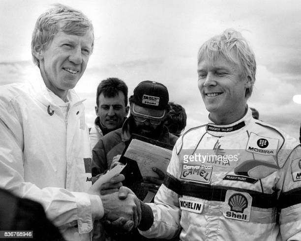 Ari Vatanen congratulates Walter Roehrl on his win in the open rally run of a time 104785 Ari came in second with a time of 105432 Walter beat the s...