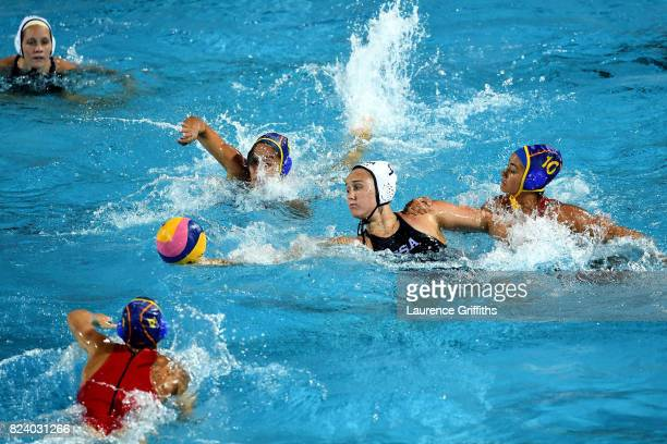 Aria Fischer of United States is closed down by Paula Crespi Barriga of Spain during the Women's Water Polo gold medal match between the United...