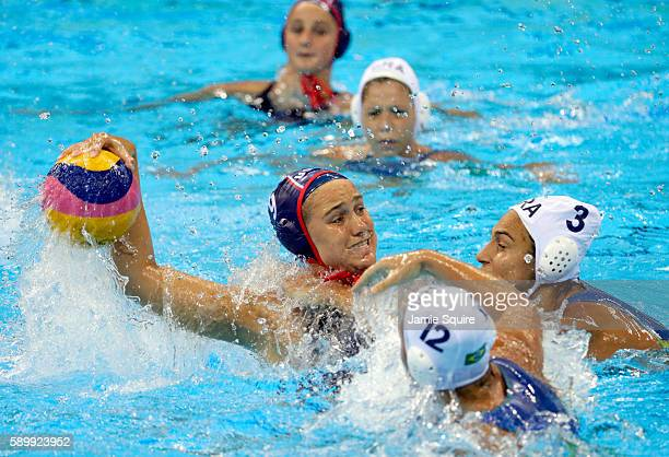 Aria Fischer of United States shoots as Marina Zablith and Gabriela Mantellato of Brazil defend during their Women's Water Polo quarterfinal match at...