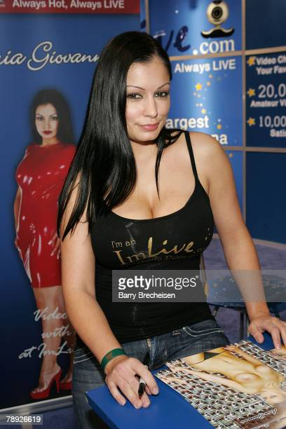 Aria Giovanni at the I'm Livecom booth in the Sands Expo Center at the 2008 AVN Adult Entertainment Expo on January 12 2008 in Las Vegas Nevada