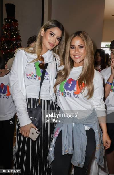 Ariadna Gutierrez and Jackie Guerrido attend the Amigos For Kids 27th Annual Holiday Toy Drive on December 16 2018 in Miami Florida