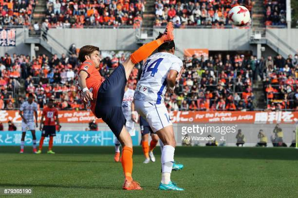 Ariajasuru Hasegawa of Omiya Ardija and Yusuke Tanaka of Ventforet Kofu compete for the ball during the J.League J1 match between Omiya Ardija and...