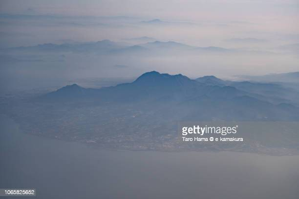 Ariake Sea and Mt. Unzen in Nagasaki prefecture in Japan daytime aerial view from airplane