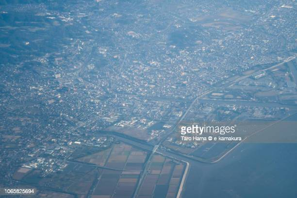 Ariake Sea and Omuta city in Fukuoka prefecture in Japan daytime aerial view from airplane