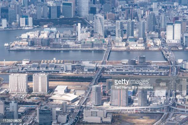 Ariake, Toyosu and Harumi Pier in Tokyo in Japan daytime aerial view from airplane