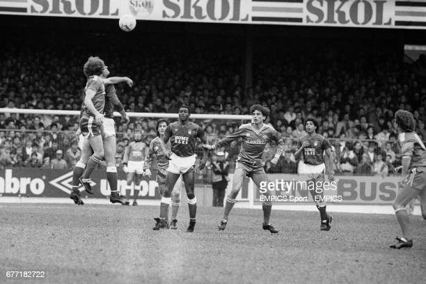 Arial action during the match watched by Leicester City's Steve Moran Chris Fairclough of Nottingham Forest Leicester City's Alan SMith and...