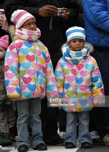 Arial Anderson and her sister Bryanna Anderson, 3 of Philadelphia, Pennsylvania watch the 6ABC/IKEA Thanksgiving Day Parade November 27, 2008 in...