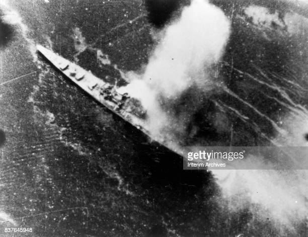 Arial view of Japanese heavy cruiser Chikuma as it takes a direct hit from US bombers Rabaul Harbor Papua New Guinea November 5 1943