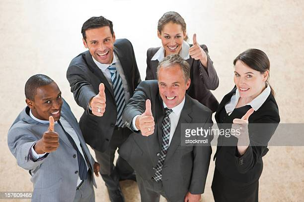 arial view of mature mixedrace business team holding thumbs up