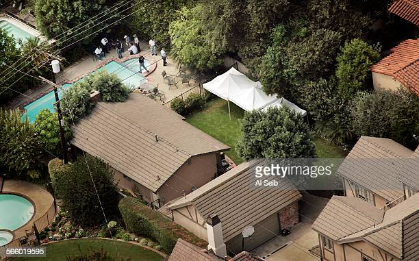 Arial view of the backyard and pool of a San Marino house where Los Angeles County Sheriff investigators friday began a ground penetrating radar...