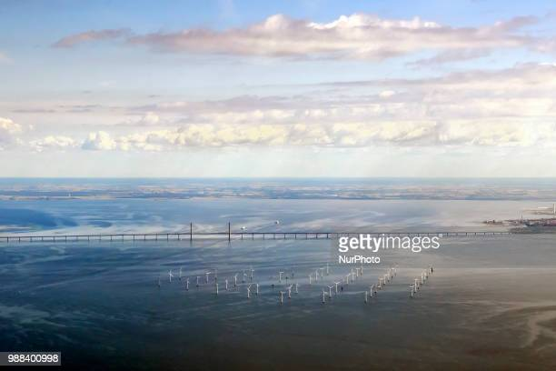 Arial view of the Wind Farm near The Øresund Bridge, Sweden, on 26 June 2018. The Øresund Bridge, a combined railway and motorway bridge between...