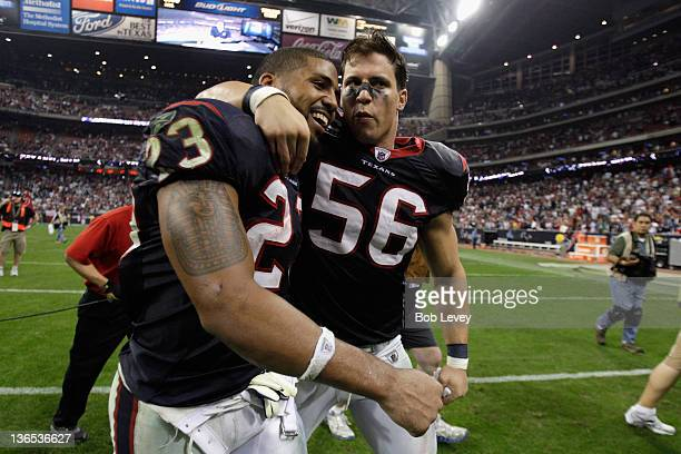 Arian Foster and Brian Cushing of the Houston Texans celebrate as they walk off of the field after they woon 3110 against the Cincinnati Bengals...
